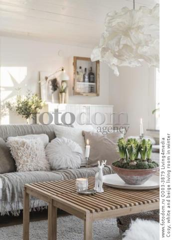 Cosy, white and beige living room in winter
