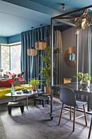 Open-plan interior in dark bold colours
