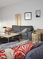 Grey couch, coffee table and baskets in living roo