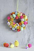 Colourful wreath of pompoms, chicks and Eater eggs