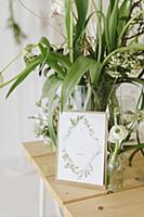Spring flowers in glass vase and wedding card
