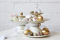 Easter eggs on cake stand made from vintage-style