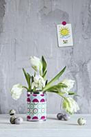 White tulips in can covered with fabric