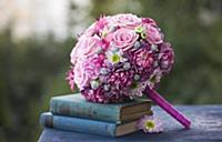 Romantic, pink bridal bouquet arranged with blue,