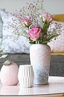 Roses and pink gypsophila in mottled vase