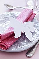 Place setting with napkin & 'Love' written on pape