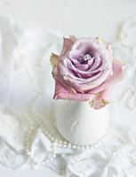 Romantic wedding decoration: ring nestled in a ros