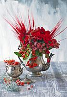 Bouquet of red-dyed barley, begonias, rowan berrie