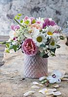 Bouquet of roses, snowberries, ox-eye daisies and