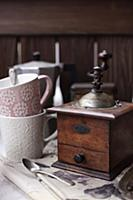Vintage coffee mill and coffee mugs