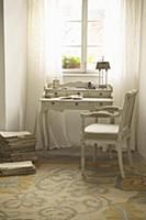 Romantic writing desk and upholstered chair in fro