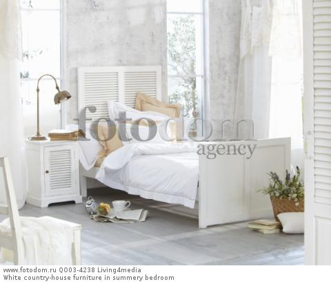 White country-house furniture in summery bedroom