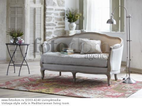Vintage-style sofa in Mediterranean living room