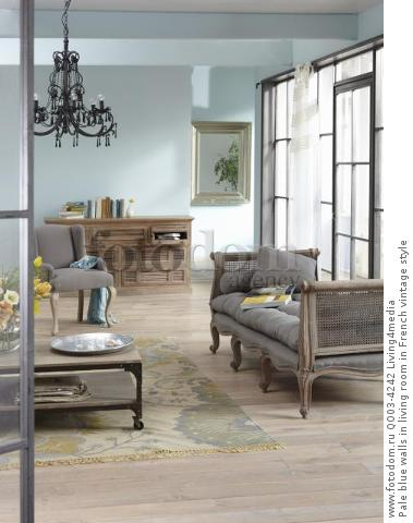 Pale blue walls in living room in French vintage style