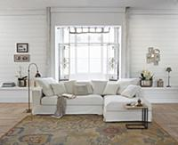 Pale sofa in front of bay window in rustic living
