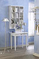 Console table below shelves mounted on pale blue w