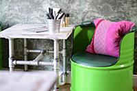 Green-painted barrel chair and vintage-style table