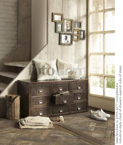 Industrial-style chest of drawers against side of steps