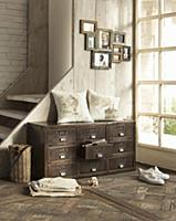 Industrial-style chest of drawers against side of