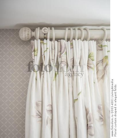 Floral curtain draped in elegant folds