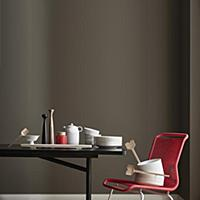 Crockery on black table and red chair in front of