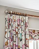 Brightly patterned curtain draped in elegant folds