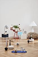 Various ornaments on side table and on pale parque