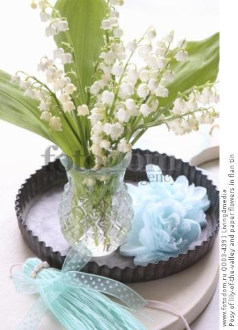 Posy of lily-of-the-valley and paper flowers in flan tin