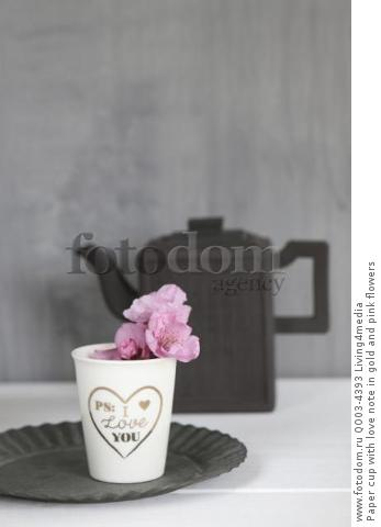 Paper cup with love note in gold and pink flowers
