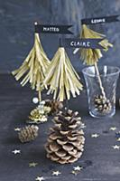 Paper fir trees with pennants on pine cones as nam