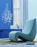 Organic easy chair in blue interior with modern ch