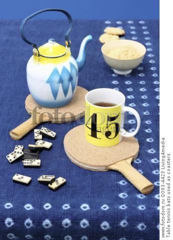 Table tennis bats used as coasters