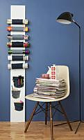 Magazine rack made from board and denim on blue wa