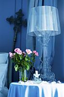 Lamp and roses on occasional table in Chвteau de l
