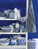 Blue-and-white country house-style crockery on a w