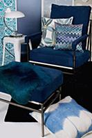 Armchair with blue upholstery, matching footstool