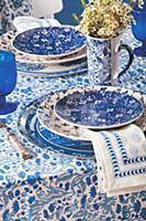 Table set in mixture of blue and white patterns