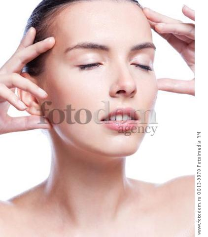Closeup portrait of a beautiful woman washing her clean face with water