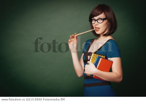 Young teacher with pointer