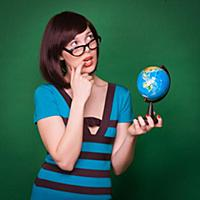 Happy geography teacher young woman hold globe and