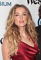 Amber Heard attends tThe Art of Elysium's Ninth An