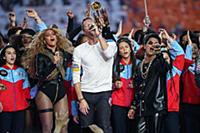 Beyonce with Chris Martin of Coldplay and Bruno Ma