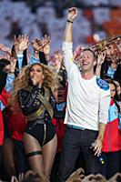Beyonce with Chris Martin of Coldplay during the h
