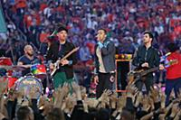 Coldplay band members Will Champion, Jonny Bucklan
