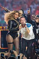 Beyonce and Chris Martin with Coldplay perform dur