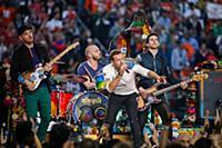 Coldplay band members Jonny Buckland, Will Champio