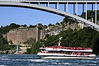 Tourists ride a boat in Niagara Falls, Ontario, Ca