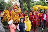 Children pose for photos with performers during bi