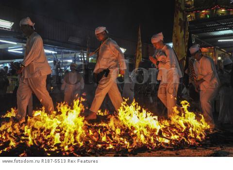 Mandatory Credit: Photo by Mohd Daud/NurPhoto/REX Shutterstock (5287894a) Malaysian Chinese devotees walk on a bed of hot coals Nine Emperor Gods Festival, Kuala Lumpur, Malaysia - 21 Oct 2015
