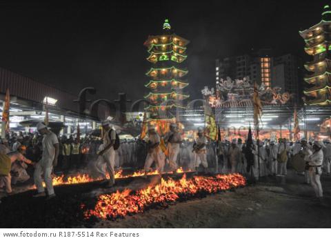 Mandatory Credit: Photo by Mohd Daud/NurPhoto/REX Shutterstock (5287894b) Malaysian Chinese devotees walk on a bed of hot coals Nine Emperor Gods Festival, Kuala Lumpur, Malaysia - 21 Oct 2015